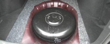 Как разместить запасное колесо, если газовый баллон установлено в багажнике?